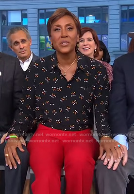 Robin's black mickey mouse print blouse and red pants on Good Morning America