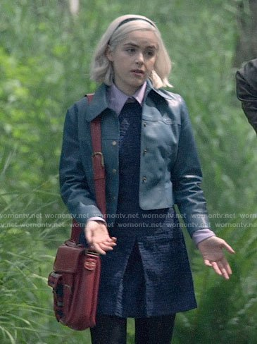 Sabrina's navy tweed dress and blue leather jacket on Chilling Adventures of Sabrina