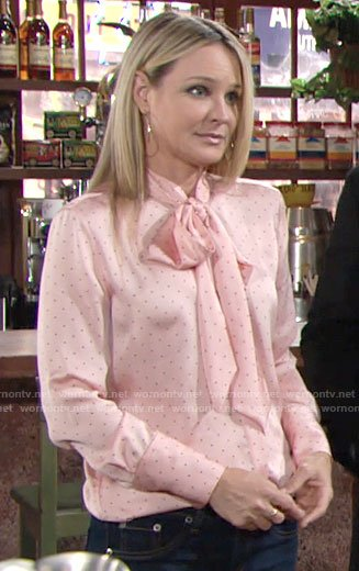 Sharon's pink dotted tie neck blouse on The Young and the Restless