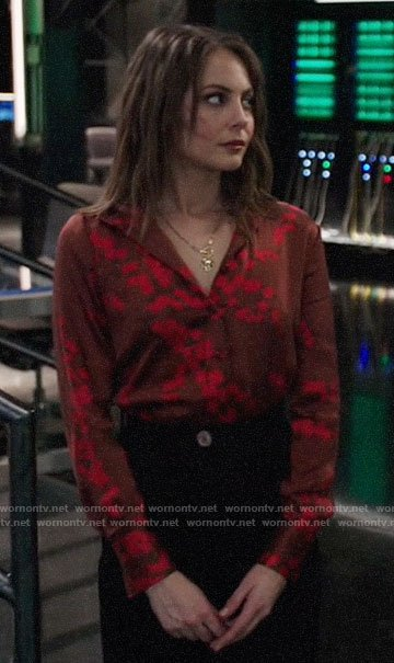 Thea's red floral button down blouse on Arrow