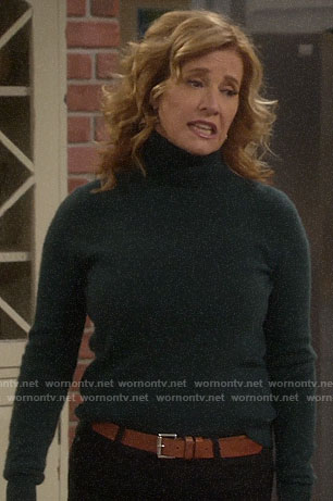 Bonnie's brown striped blouse on Last Man Standing