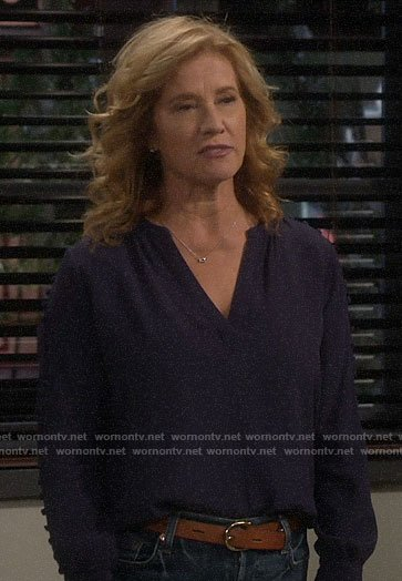 Vanessa's navy buttoned sleeve blouse on Last Man Standing