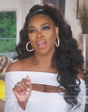 Kandi's leaf print jumpsuit and belt bag on The Real Housewives of Atlanta