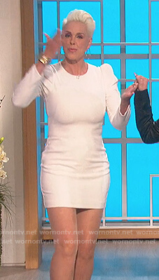 Brigitte Nielsen's white puff sleeve mini dress on The Talk