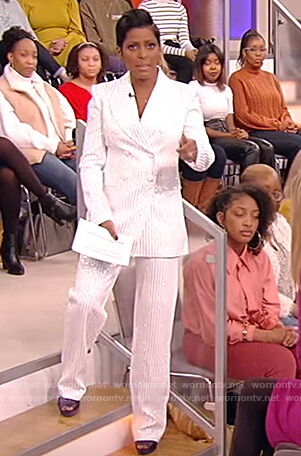 Tamron's white pinstripe blazer and pants on Tamron Hall Show