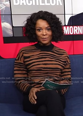 Zuri's brown tiger print sweater on Access Hollywood
