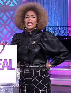 Amanda's black puff sleeve jacket and check skirt on The Real