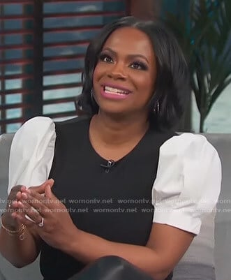 Kandi Burruss's black and white puff sleeve top on Access Hollywood