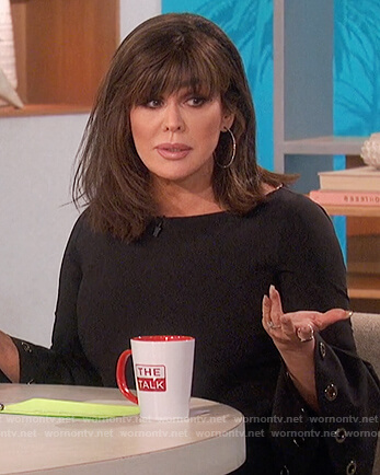 Marie's black grommet bell sleeve top on The Talk