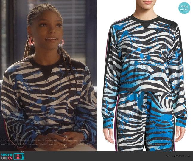 Nola Zebra-Print Cropped Sweatshirt by No Ka Oi worn by Skylar Forster (Halle Bailey) on Grown-ish