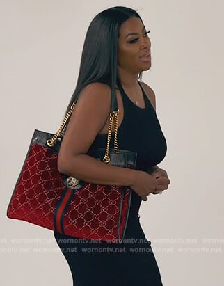 Kenya's black dress and bag on The Real Housewives of Atlanta