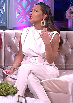 Adrienne's white pleated shoulder top and belted pants on The Real
