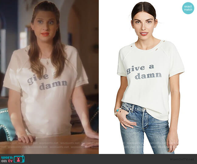 Give A Damn Short Sleeve Sweatshirt by AMO worn by Nomi Segal (Emily Arlook) on Grown-ish