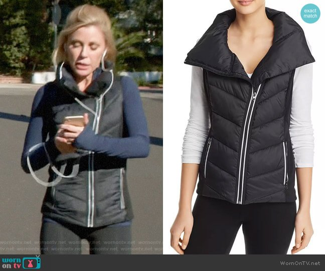 Aqua Asymmetric Puffer Vest worn by Claire Dunphy (Julie Bowen) on Modern Family