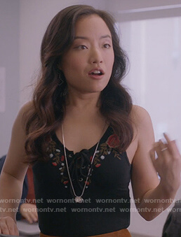 Janet's black floral embroidered bodysuit on Kims Convenience