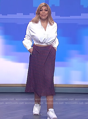 Wendy's white tie shirt and blue geometric skirt on The Wendy Williams Show