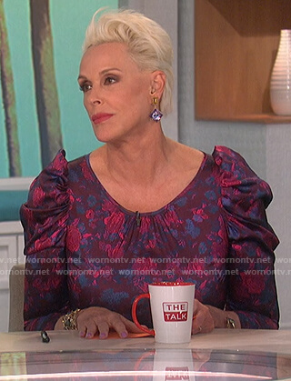 Brigitte Nielsen's purple floral mini dress on The Talk