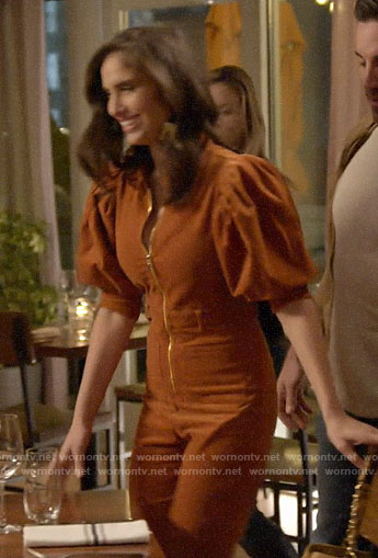 Brittainy's orange puff sleeve jumpsuit on Very Cavallari