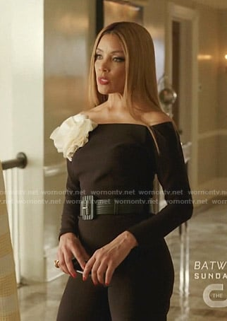 Dominique's black off-shoulder jumpsuit with white flower on Dynasty
