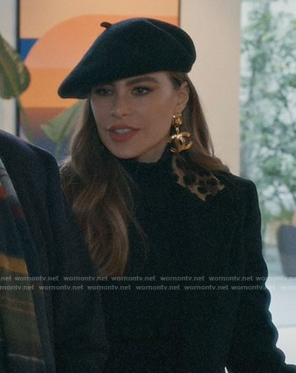 Gloria's black leopard collar coat in Paris on Modern Family