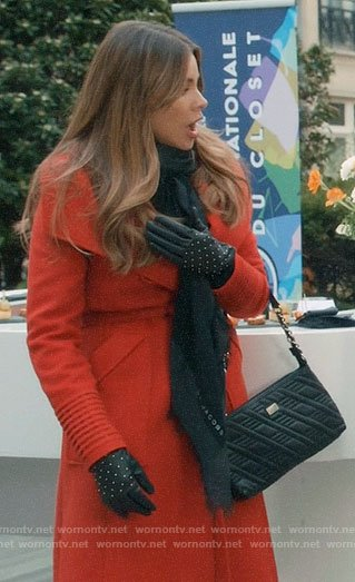 Gloria's red wrap coat in Paris on Modern Family