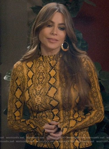 Gloria's yellow snake print top on Modern Family