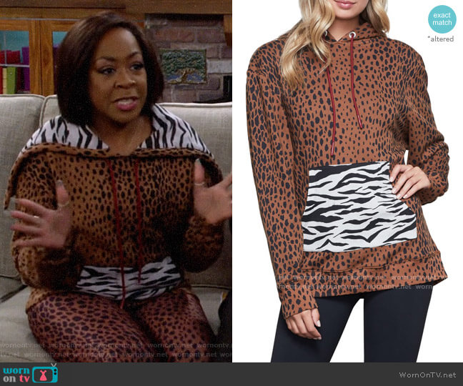 Good American Mixed Animal Hoodie worn by Tina (Tichina Arnold) on The Neighborhood