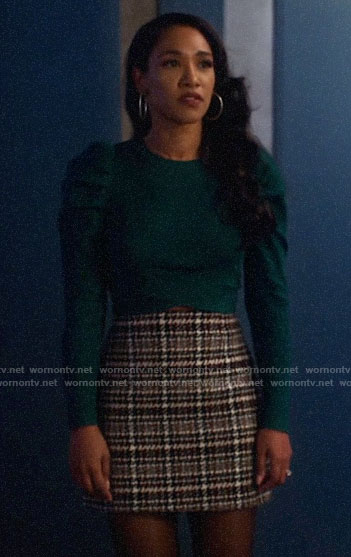 Iris's green cropped puff sleeve sweater and checked skirt on The Flash