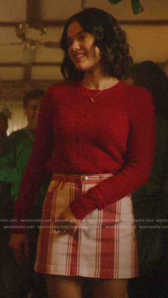 Katy's red cable knit sweater and striped skirt on Katy Keene