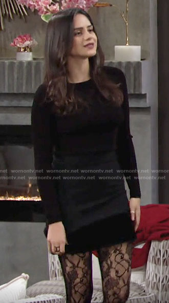 Lola's black lace-up back top and fur trim skirt on The Young and the Restless