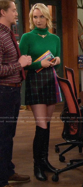 Mandy's green turtleneck and multi-colored check skirt on Last Man Standing
