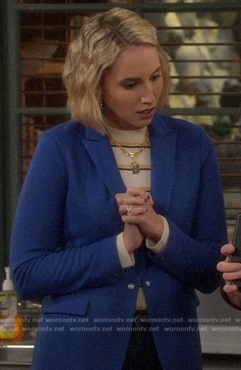 Mandy's striped sweater and blue blazer on Last Man Standing