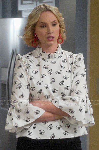 Mandy's white eye print top on Last Man Standing