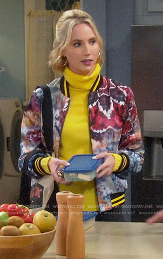Mandy's yellow turtleneck and printed bomber jacket on Last Man Standing