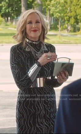 Moira's black embellished stripe dress on Schitts Creek