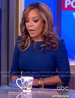 Sunny's navy split neck sheath dress on The View