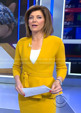 Norah's yellow wrap peplum jacket and pencil skirt on CBS Evening News