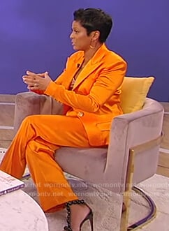 Tamron's orange satin blazer and pants on Tamron Hall Show