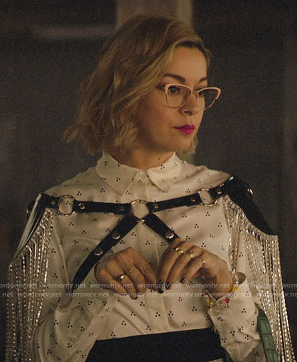 Pepper's white dotted shirt and fringed harness on Katy Keene