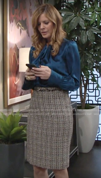 Phyllis's blue tie neck blouse and tweed pencil skirt on The Young and the Restless