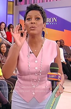 Tamron's pink button vest and blue skirt on Tamron Hall Show