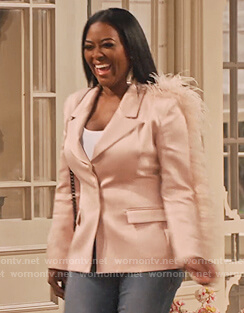 Kenya Moore's pink blazer with leather trim on Family Reunion