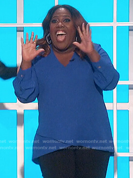 Sheryl's blue v-neck top on The Talk