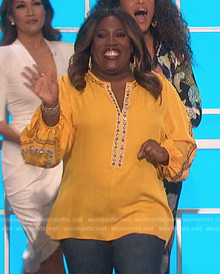Sheryl's yellow embellished blouse on The Talk