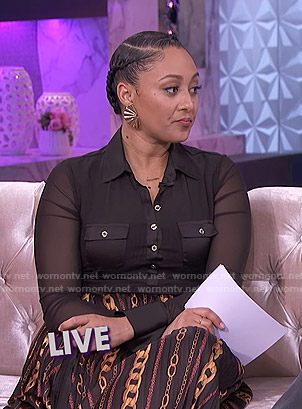 Tamera's black mesh button down top and chain print skirt on The Real