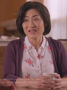 Uma's white rose print sleeveless top on Kims Convenience