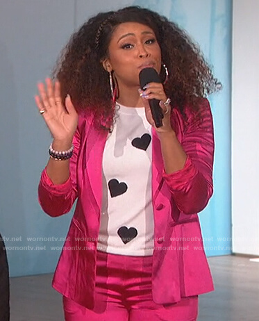 Eve's white heart print sweater on The Talk