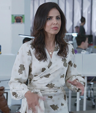 Kendra Zahir's white paisley print wrap blouse on Good Trouble