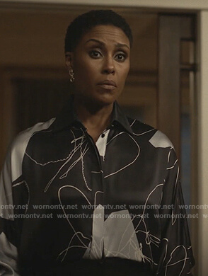 Lynn's navy abstract print blouse on Black Lightning