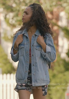Olivia's studded denim jacket and floral shorts on All American